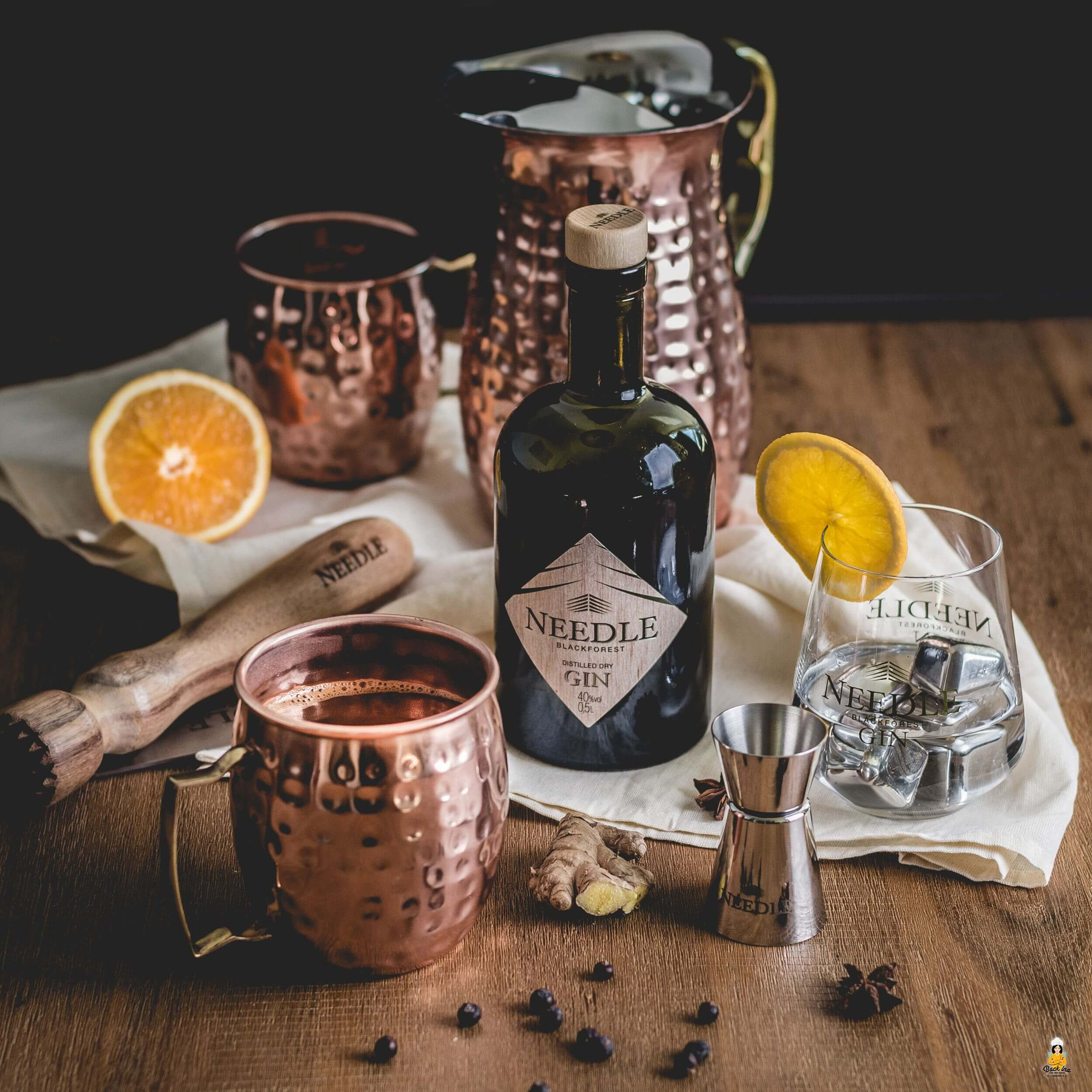 Gin Cocktail mit Apfelsaft und Orangensaft für den Winter: Glüh-Gin